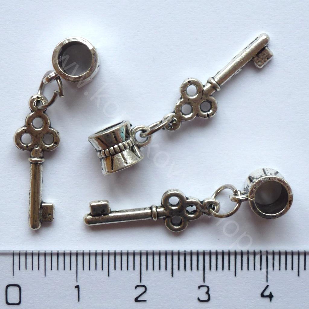 Korálek s velkým průvlekem - klíč
